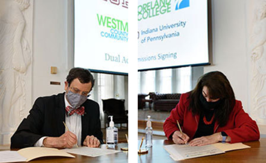 Michael Driscoll, left, and Tuesday Stanley, right, in separate photos, sign documents during the signing ceremony