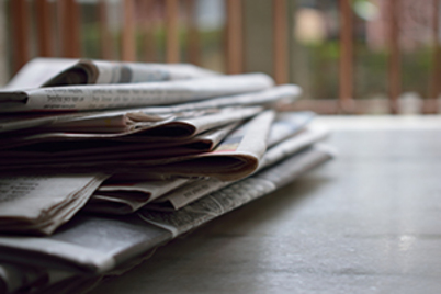 Stack of newspapers seen from the side