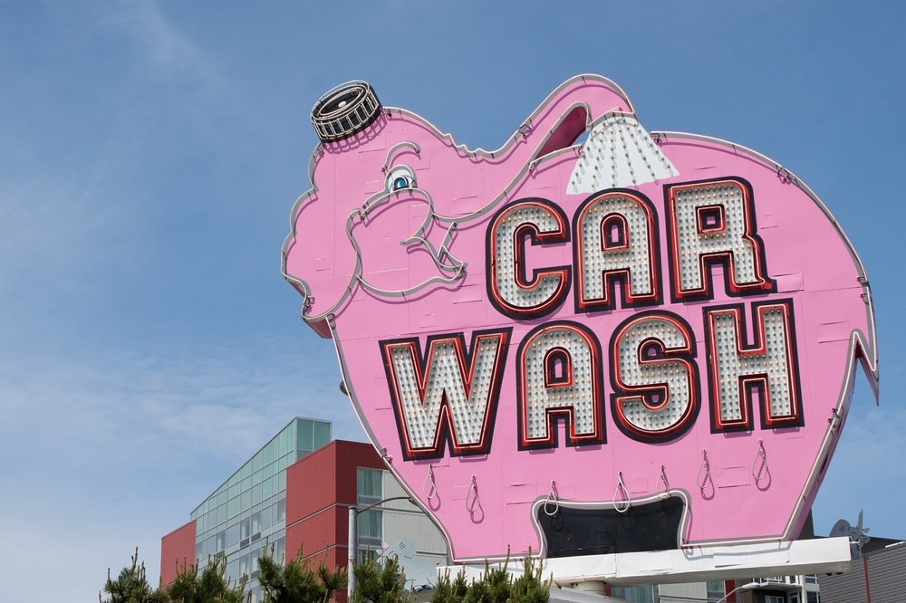 The neon sign for the Pink Elephant Car Wash