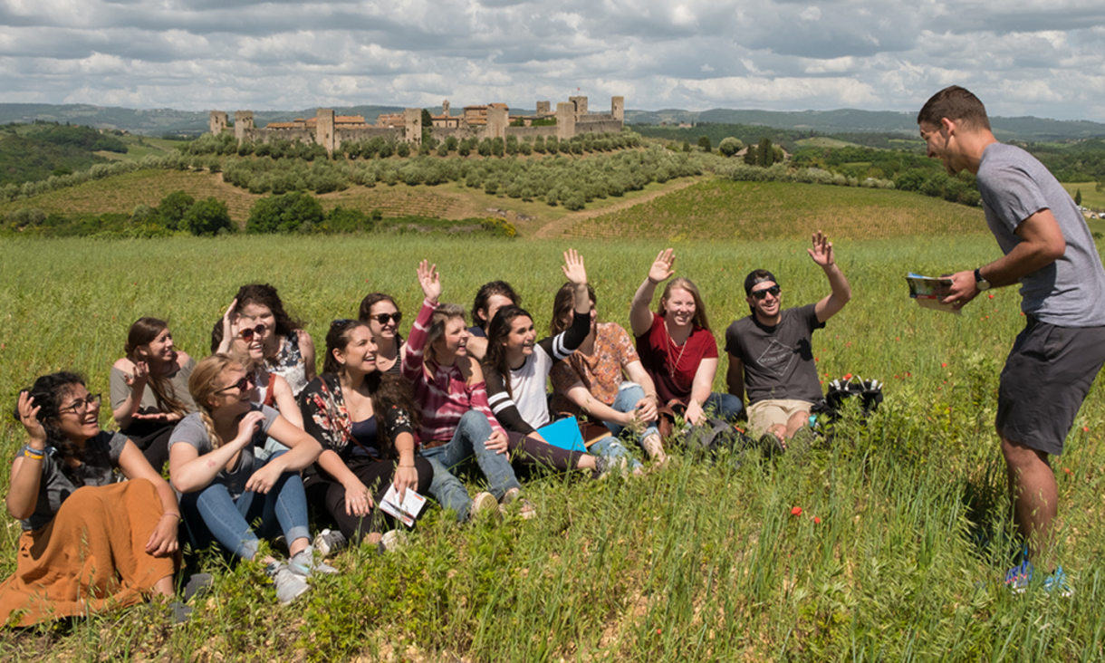 A group of NAU students studying abroad and participating in an immersive class outdoors.