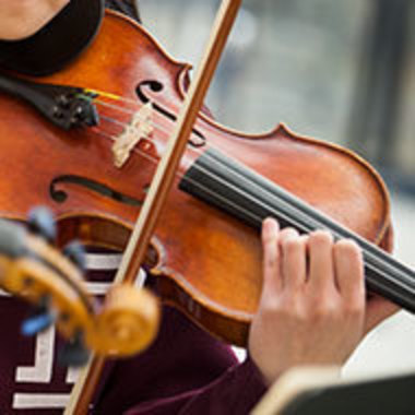 Closeup of student playing violin