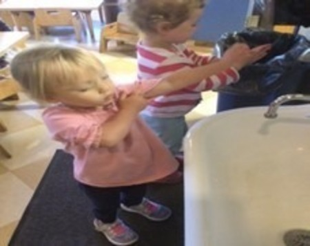 toddlers playing at table