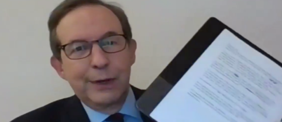 Chris Wallace holding a binder