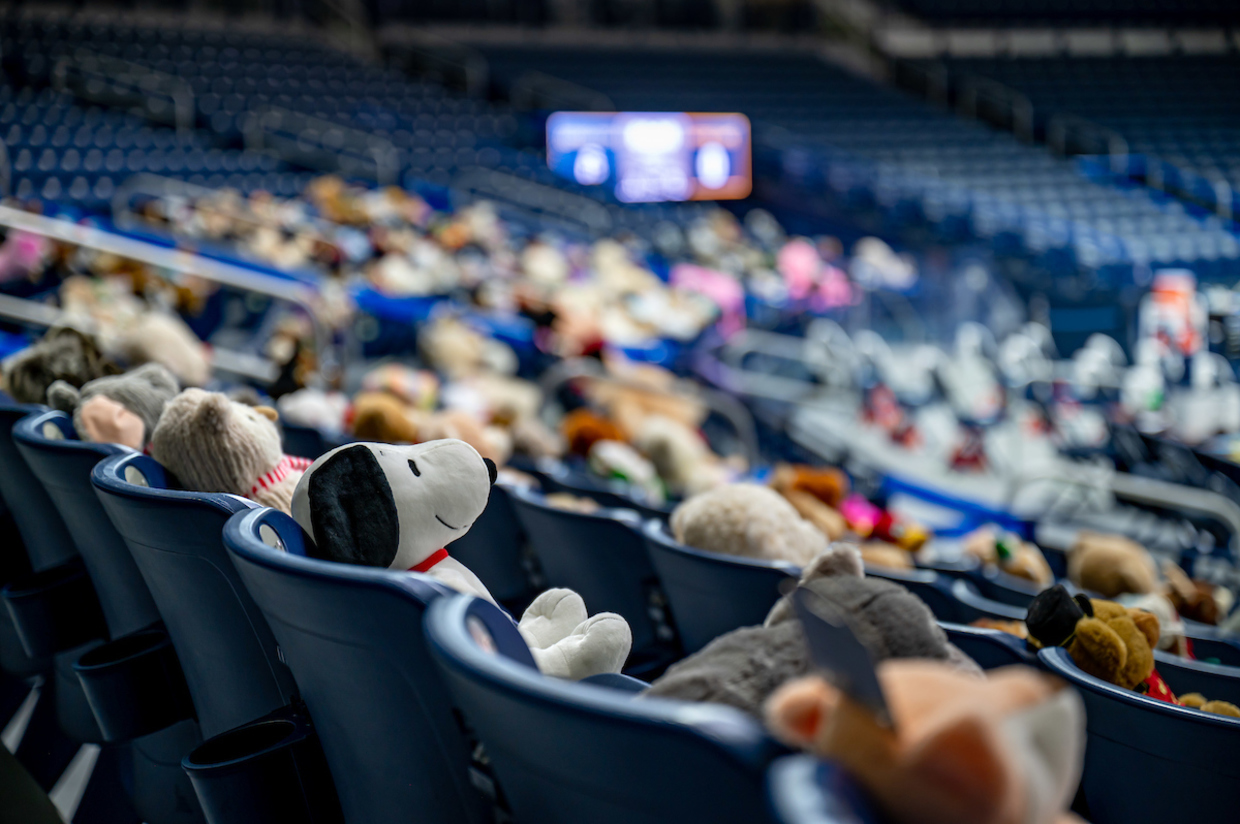 Photo of stuffed animals in seats at the JACC