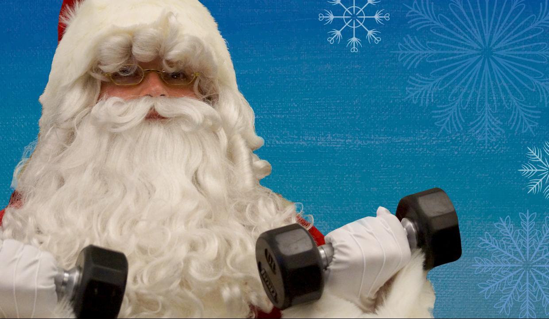 Photo of Santa holding dumb bells
