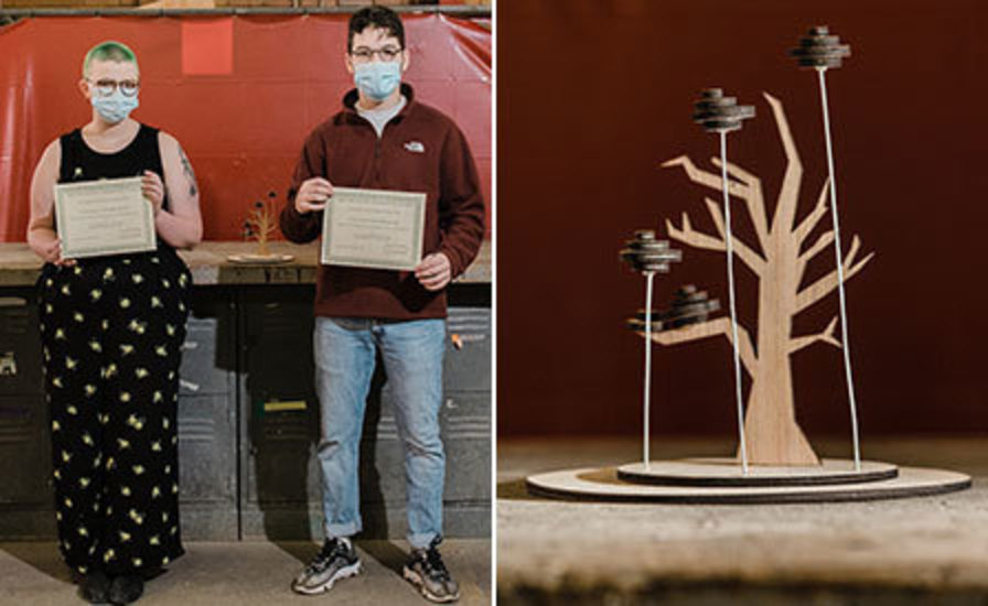 side-by-side photos of the two competition winners holding certificates and a model of their proposed sculpture