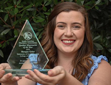 Morgan Grier holding award