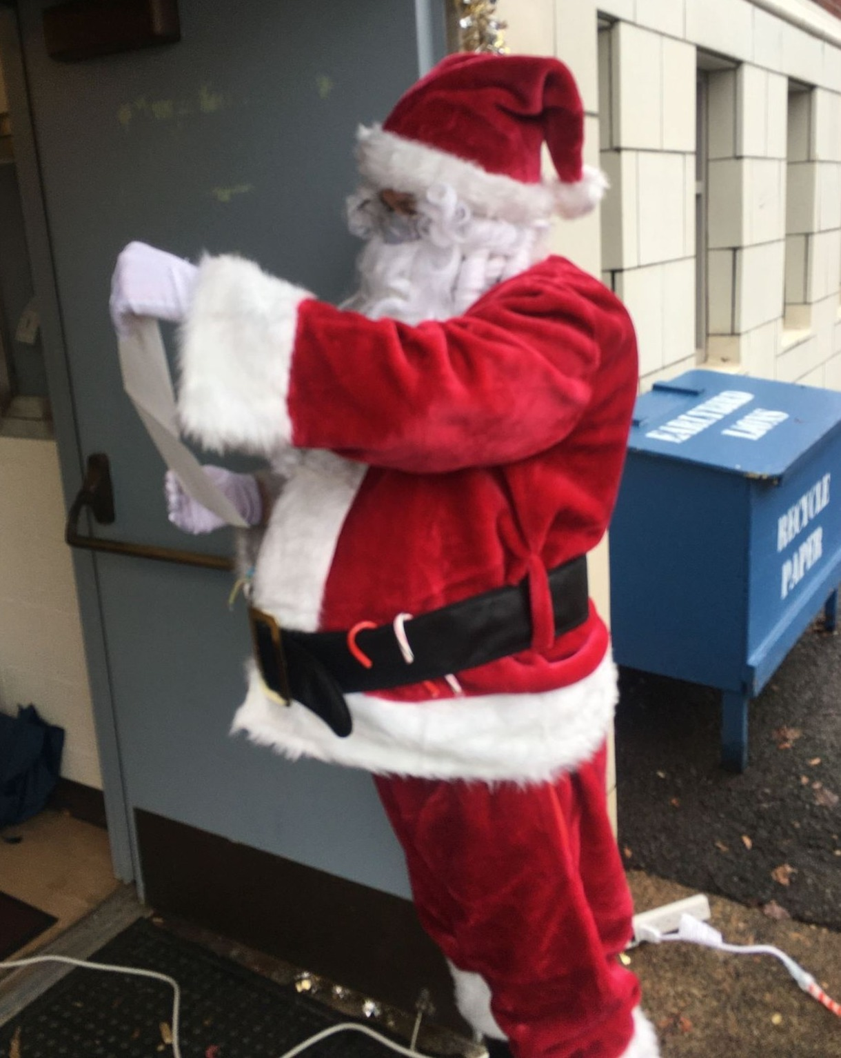 Santa reads a letter he received during Santa Drive-Thru on December 19, 2020.