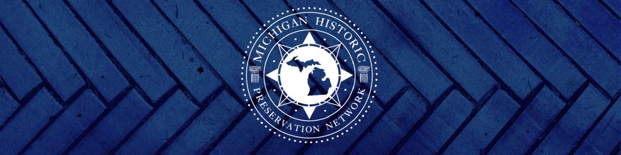 MHPN logo with brick pattern background