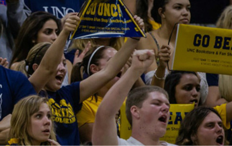 Students in UNC gear cheer in stadium