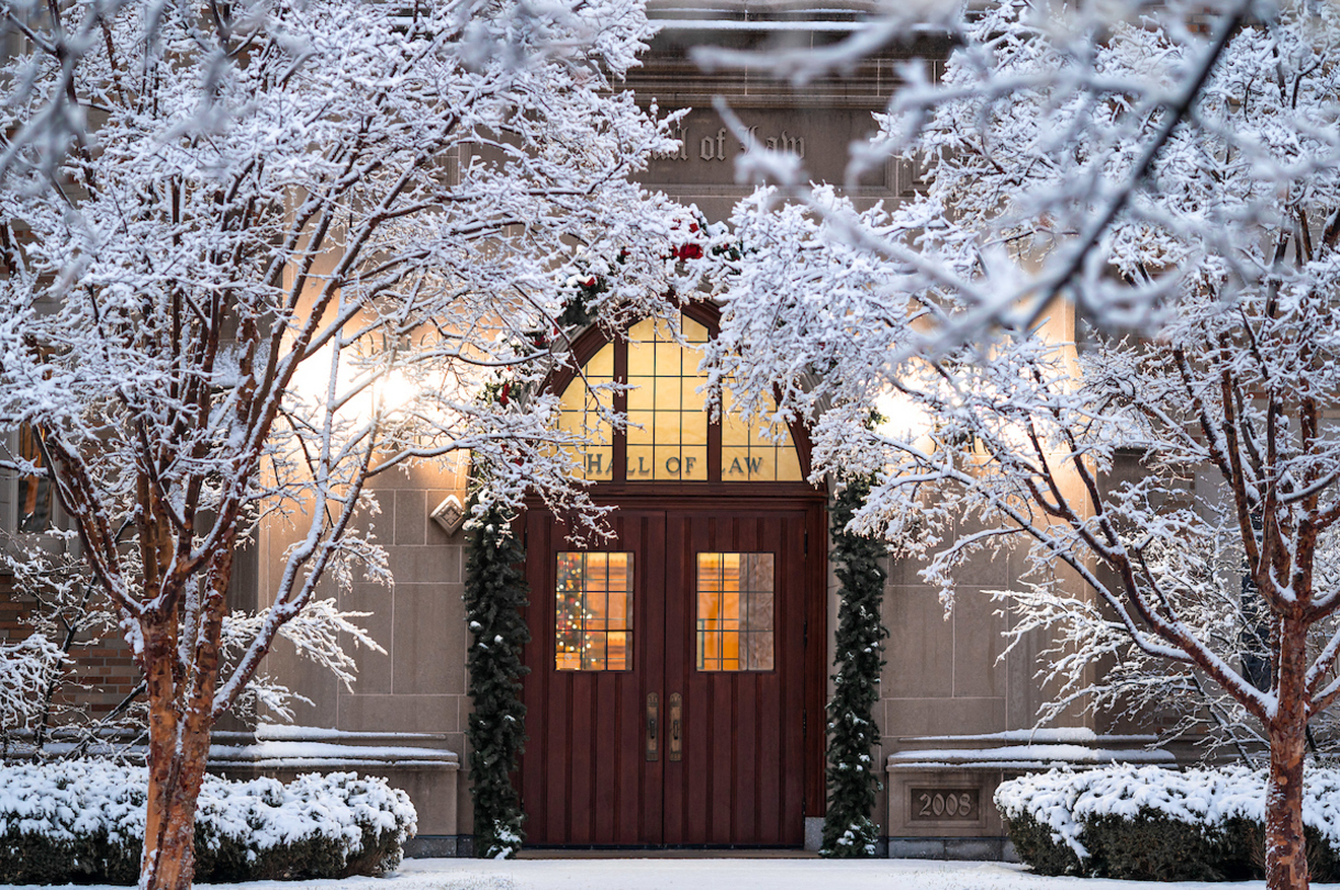 Winter photo of the Eck Hall of Law.