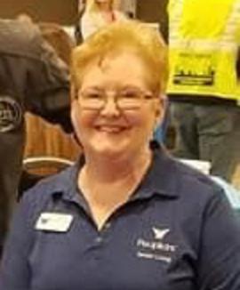 Donna Cieslinski, wearing a People Inc. polo shirt.