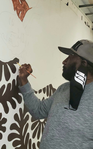 An artist working on the mural.