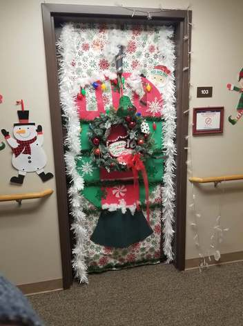 A very festive holiday decorated door.