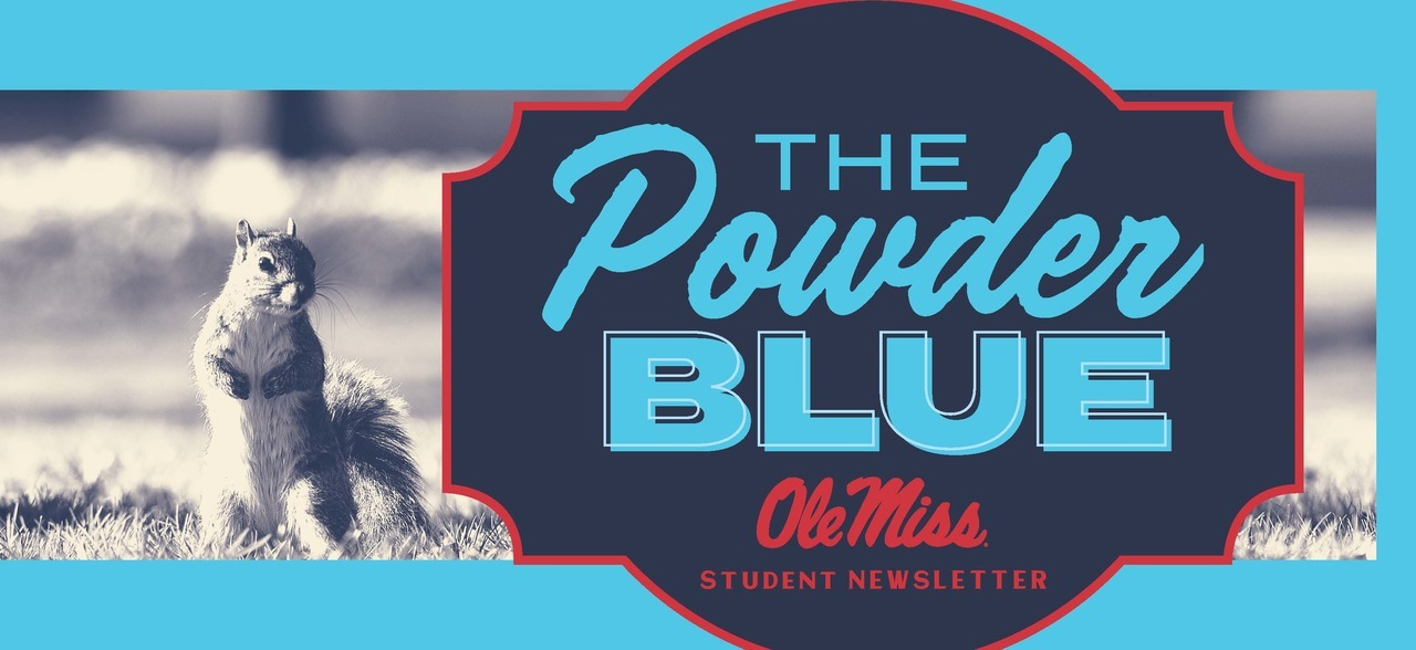 Photo with squirrel on the left and Logo on the right that reads: The Powder Blue in red and light blue