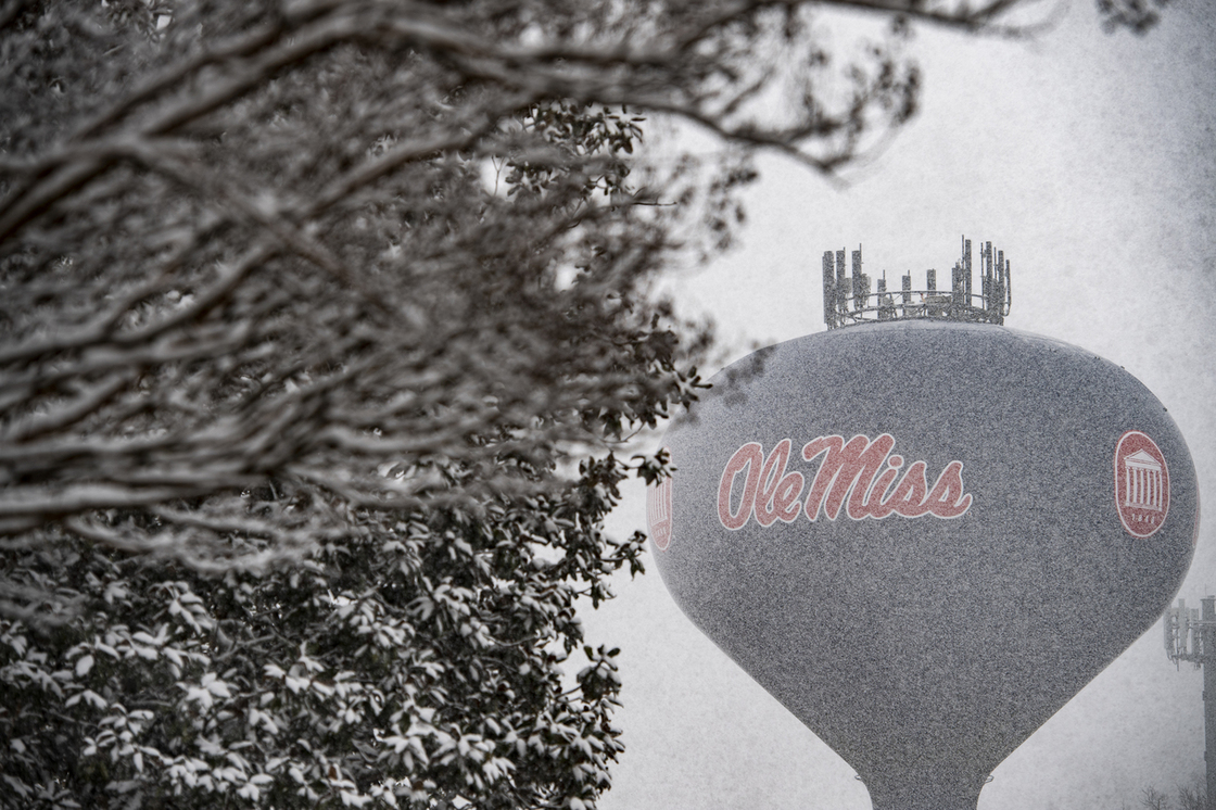 Ole Miss water tower in the distance with snow flurries distorting the imagry
