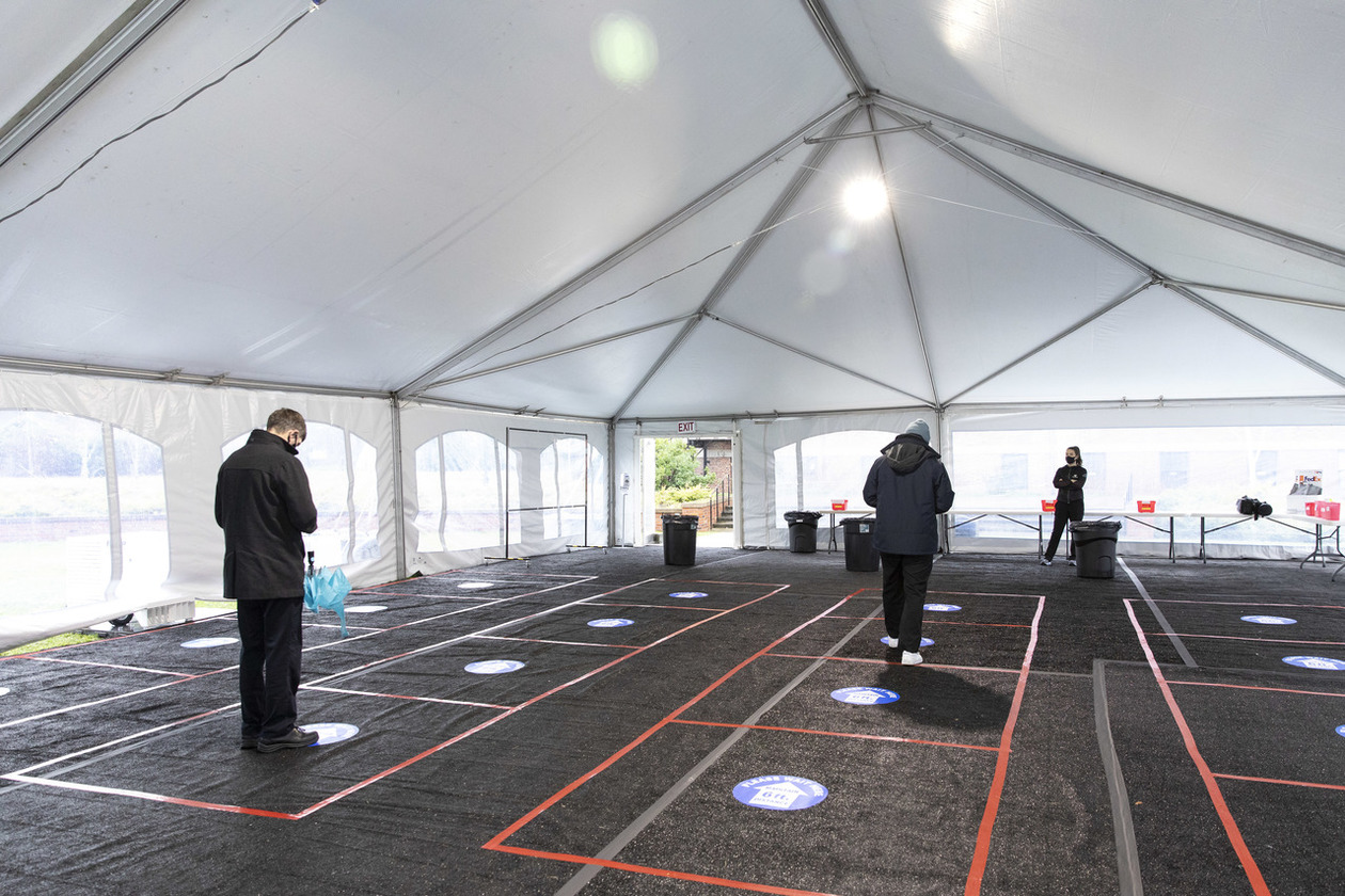 Students stand inside the testing pavilion during a COVID-19 spring testing rehearsal