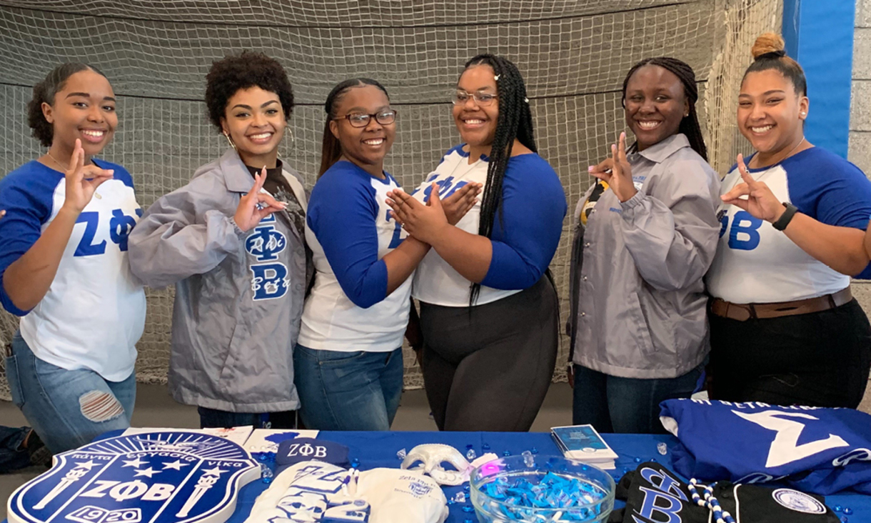 A group of NAU students dressed in blue and white participating in a Fraternity and Sorority Life recruitment event.