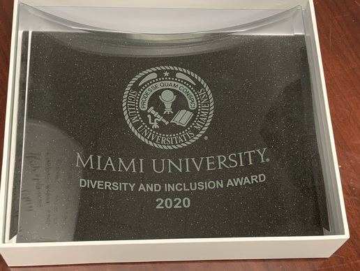 A glass award engraved with