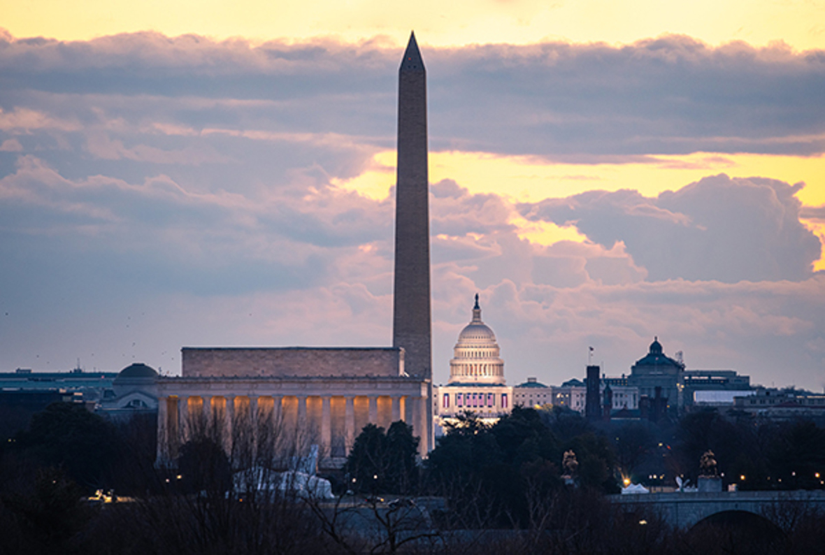 Inauguration Day 2021 sunrise over US Capitol, Washington Monument, Lincoln Memorial