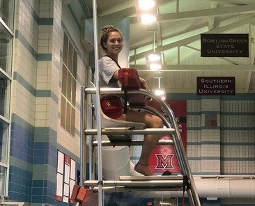 Lifeguard sitting in chair above Miami University pool