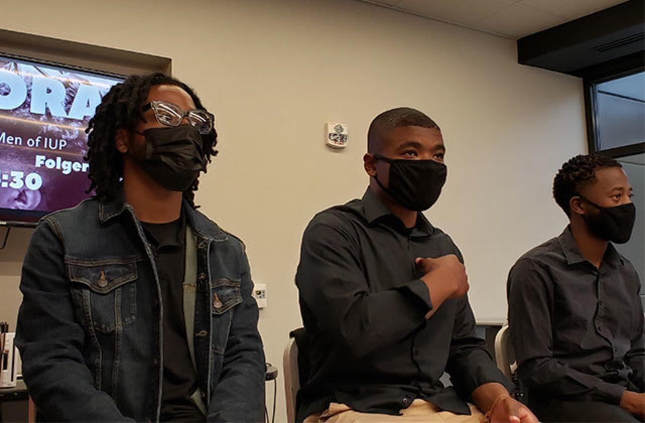From left, Samaj Schell, Malik Turner, and Davis Kazako during a Ubora Men meeting