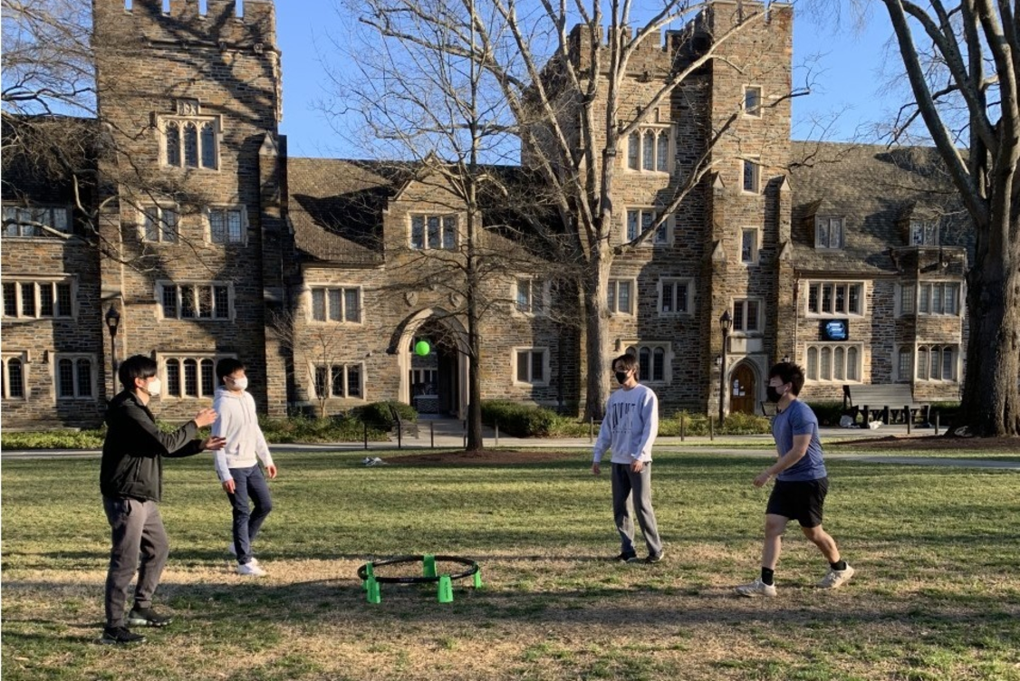 photo of 4 duke students playing spikeball on the main quad