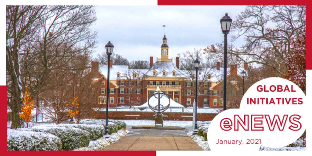 Light snow covers campus as we look toward Mc Cracken Hall, with sundial visible in foreground