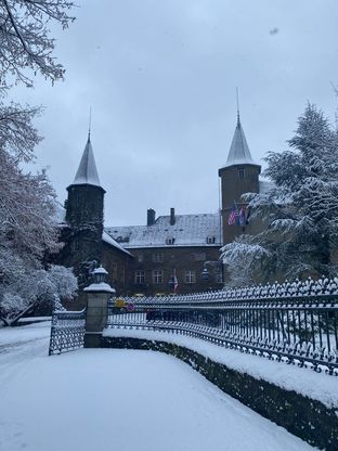 Snow-covered chateau and lane