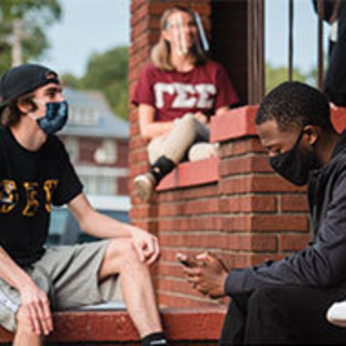 students wearing masks while hanging out