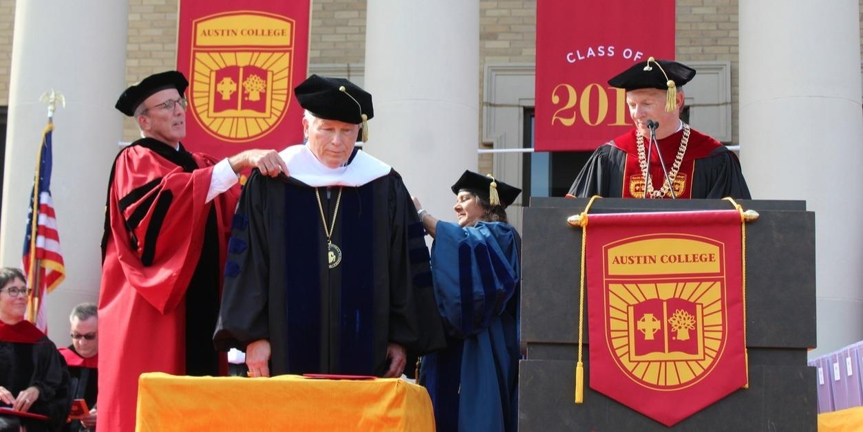 Dean Sheila conferring an Honorary Doctorate to former UCF President, John Hitt