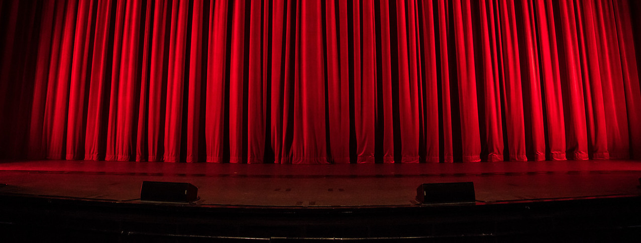 Photo of closed theater curtain