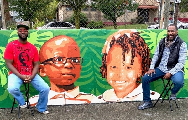 Billingsley (L) and Michael Coppage (R) in front of the Avondale mural.