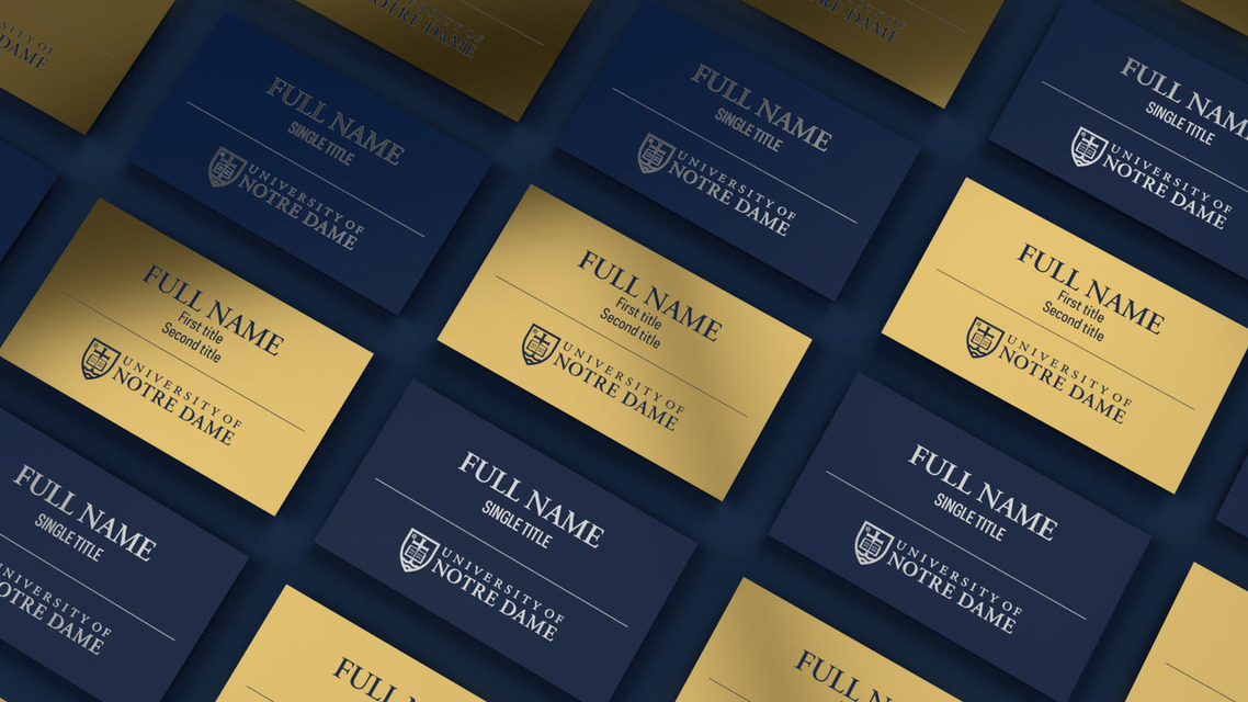 Blue and gold name badges cover a surface