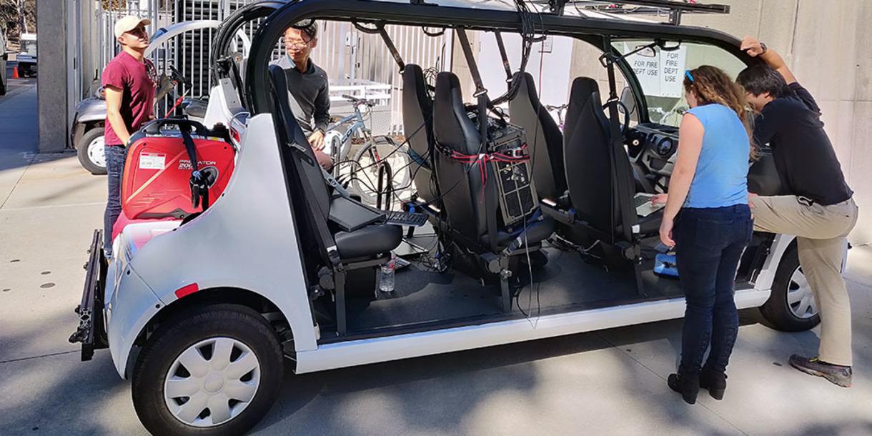 Students work on an autonomous vehicle