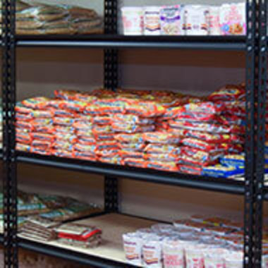 food pantry shelves with Ramen noodles and more