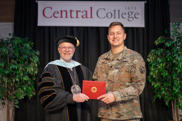 Photo of Central College President Mark Putnam handing Logan Price his diploma at a special Commencement ceremony for the serviceman