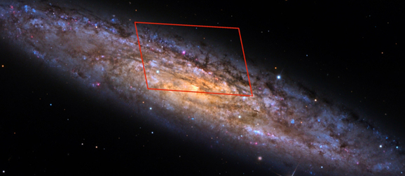 A galaxy with a red square highlighting something in the center