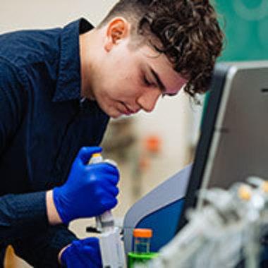 Arie Van Wieren working in the biochemistry lab