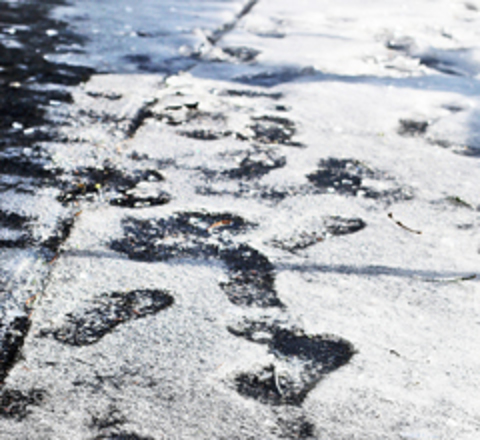 slushy footprints in the snow