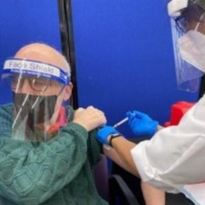 Senior getting vaccinated