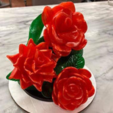 three red roses made of sugar