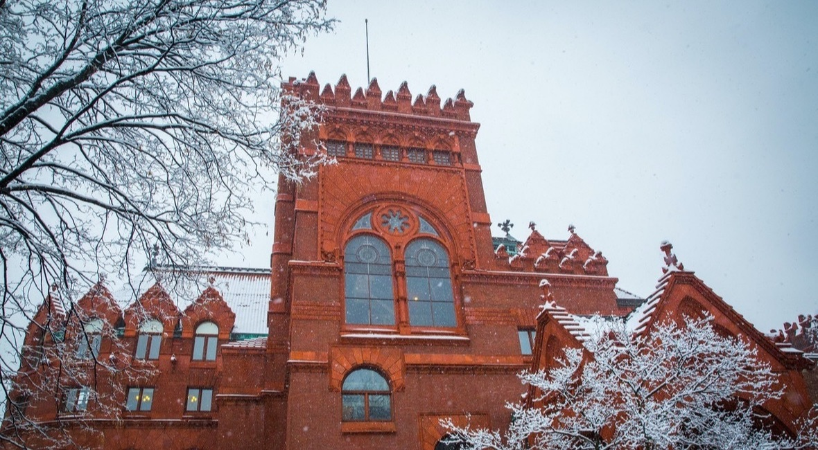Fisher Fine Arts Library amid snow-covered tree branches