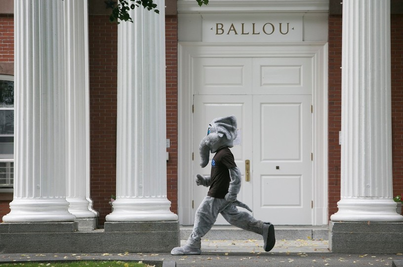 Jumbo mascot walking past Ballou Hall