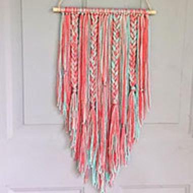 multicolored yarn wall hanging on a door
