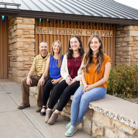 Four Deming family members outside of McPherson Chapel