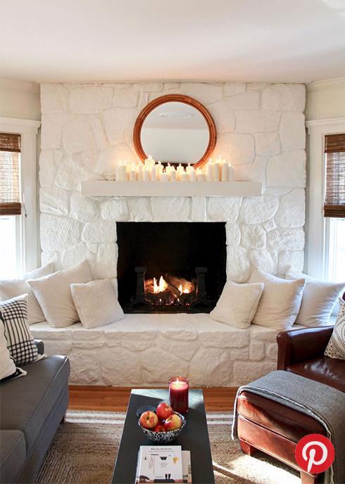 A white stone fireplace