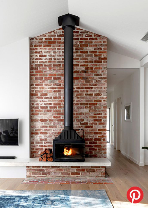A wood stove style fireplace