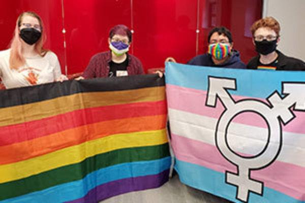 Pride Alliance officers, from left, Elizabeth Rinde, Nic Sealer, Sasha Aquino, and Kaycee Morgan hold pride flags