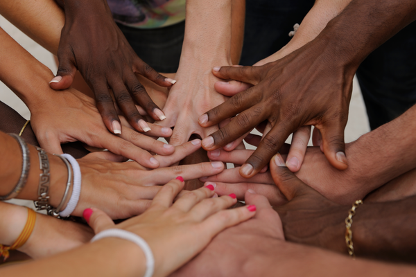 Several hands reflecting different races on top of each other